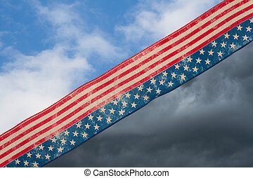 Retro USA stars and stripes burlap ribbon with bright and stormy sky background