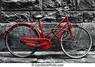 Retro vintage red bike on black and white wall. Old charming...