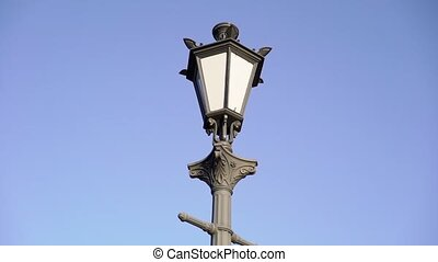 Retro vintage street lamp in a city