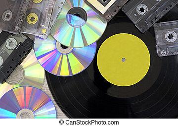 Retro, vinyl record disc, audio cassette and cd close up...