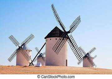 retro windmills in La Mancha region - Group of retro...