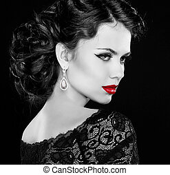 Retro woman. Fashion model girl portrait. Black and white photo. Isolated on black background.