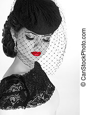 Retro woman. Fashion model girl portrait. Black and white photo.