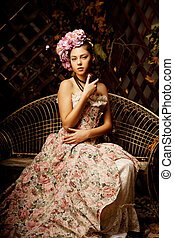Retro woman. Girl in vintage style with flowers in hairstyle