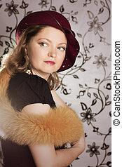 Retro woman in hat and boa