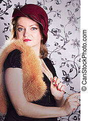 Retro woman in hat over glamorous background