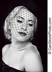 Retro woman. Jewelry and Beauty. Fashion photo
