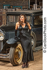 Retro Woman Near Old Car - Vintage automobile and beautiful...