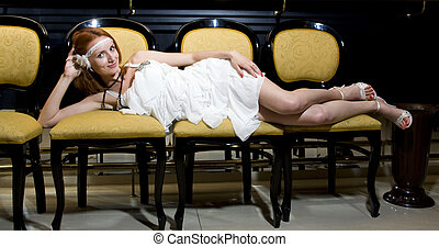 Retro woman on old-fashioned chairs
