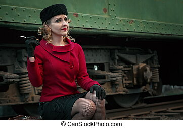 Retro woman on the train station