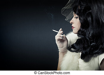 Retro woman smoking on dark background