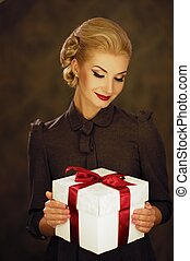 Retro woman with a gift box