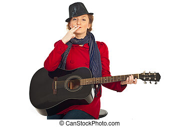 Retro woman with cigarette and guitar