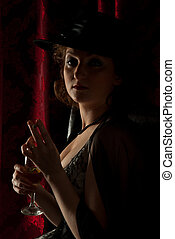 Retro woman with hat in dark