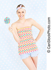 Retro woman with lollipop