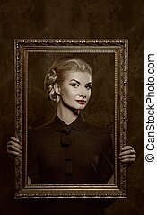 Retro woman with picture frame.