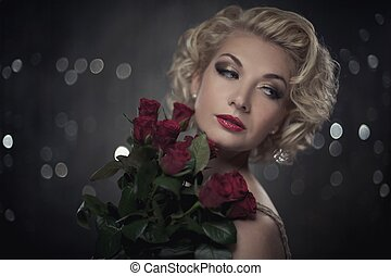 Retro woman with red roses portrait