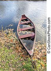 retro wooden boat in autumn