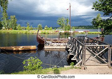 Retro wooden boats near a pier