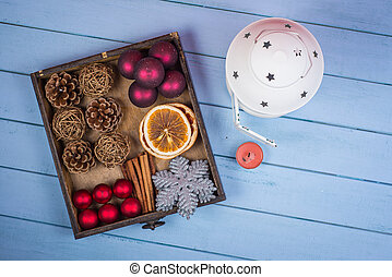 Retro wooden box with Christmas decorations and lantern