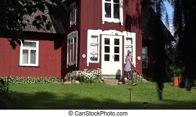 Retro wooden garden summer house through moving tree branches. 4K