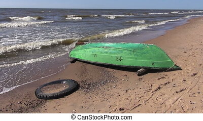 retro wooden green boat on beach