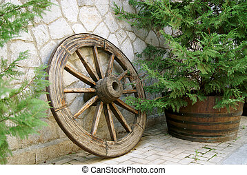Retro wooden wheel on the pave street