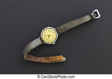 Retro wristwatch on black background