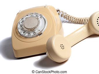 Retro yellow phone isolated on white background