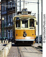 Retro yellow tram on the street
