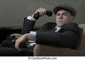 Retro young man in tweed jacket