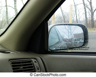 retroviseur - the rear-view mirror of a car with a French...