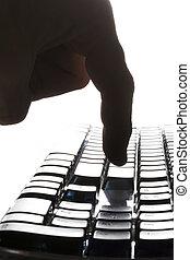 Finger touching the return key