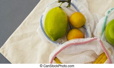 reusable shopping bags for food with fruits - food shopping,...