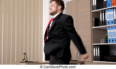 Revealing shot of businessman in black suit and red tie...