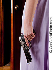 Revenge - Woman waiting at the door with a revolver in her...