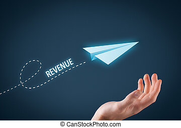 Increase revenue concept. Paper plane representing dreaming about growing revenue and hand touching this dream comes true.