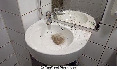 Reverse flow of sewage water in the washroom. Sewerage malfunction.