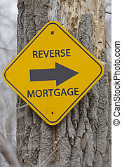 Reverse Mortgage Arrow sign on tree making a great concept.