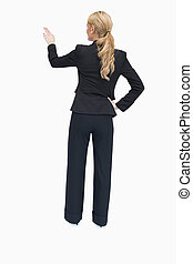 Reversed businesswoman showing something - Businesswoman ...