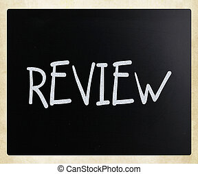 """""""Review"""" handwritten with white chalk on a blackboard"""
