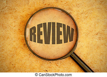 Review - Magnifying glass focused on the word review