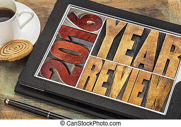 2016 review banner - annual review or summary of the recent year - word abstract in vintage letterpress wood type blocks on a digital tablet with coffee