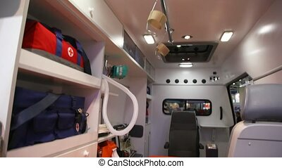 car fast inside from ceiling with lamps and arms to floor...