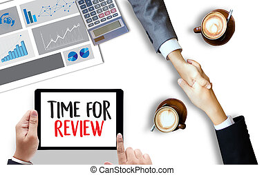 review time Business Concept , time for review , Business team hands at work with financial reports and a laptop