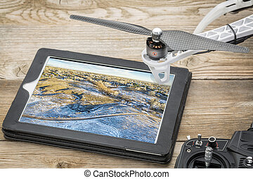 reviewing aerial picture on tablet
