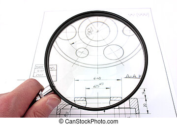 Reviewing technical drawing with magnifying glass. Focus on magnifying glass.