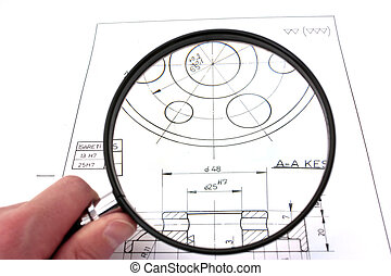 Reviewing technical drawing with magnifying glass. Focus on technical drawing.