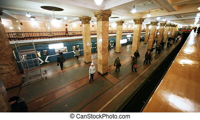 Revival of passengers on subway, left stands train and other...