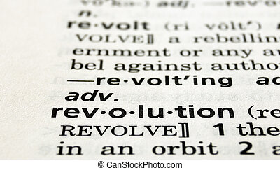The word revolution in a dictionary, close-up